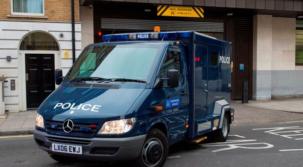 A police van carrying the Royal Marine leaves court in London