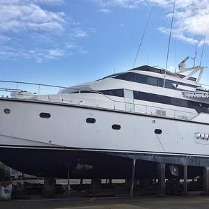 The auction items include an Italian super-yacht