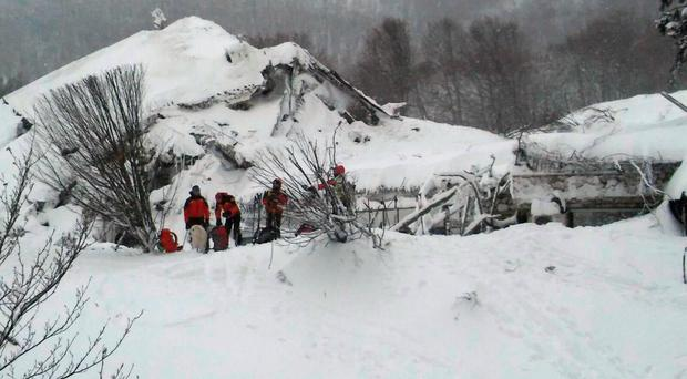 Rescuers take part in a salvage operation in front of the Hotel Rigopiano which was engulfed by a powerful avalanche in Farindola, Italy
