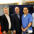 Patient Donie Cronin (centre) with clinical personnel (from left) Bernie McCallan, Dr Aaron Peace, Dr Godfrey Aleong and Dr Albert McNeill at Altnagelvin Hospital