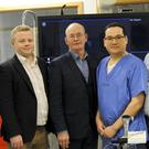Donie Cronin, centre, with clinical personnel at Altnagelvin Hospital (Western Health & Social Care Trust/PA)