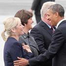 Michelle O'Neill and Arlene Foster welcome former US President Barack Obama for the G8 Summit