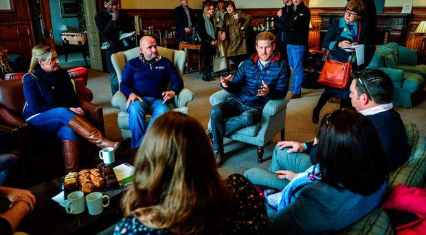 Prince Harry speaks with the former soldiers during a visit to a Help For Heroes recovery centre at Tedworth House in Tidworth, Wiltshire