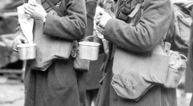 Soldiers of the American Army's 34th Infantry Division having a snack at LMS Station after disembarking in Belfast in 1942