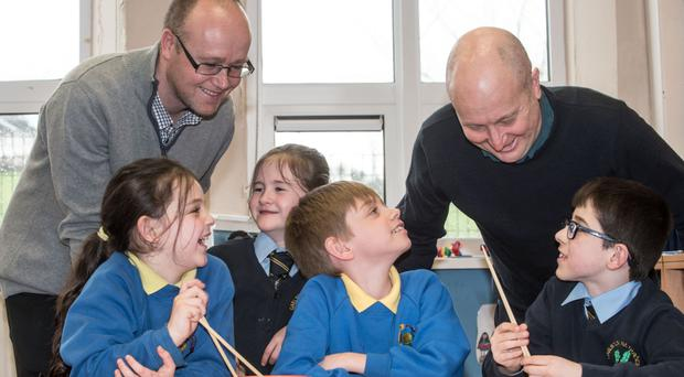 Oisin Mac Eo (left), principal of Gaelscoil na Daroige, and Nick Tomlinson (right), Groarty Integrated Primary School principal, with (from left) Yasmin Jalloul, Groarty Integrated Primary School, Dearbhaile Ni Chearullain, Gaelscoil na Daroige, Oisin Brown and Seosamh O Cearrullain, from Gaelscoil na Daroige