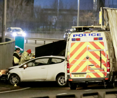 Police at the scene of the collision last night