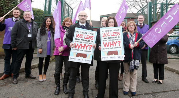 INTO teachers stage a half-day strike outside St Therese of Lisieux Primary School in north Belfast earlier this month