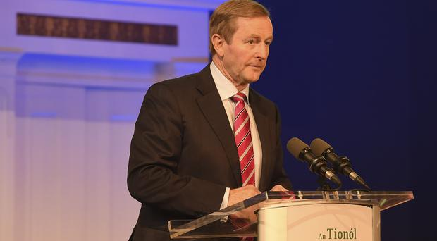Political rivals have called on Enda Kenny to turn down an invite to the White House due to Donald Trump's travel ban
