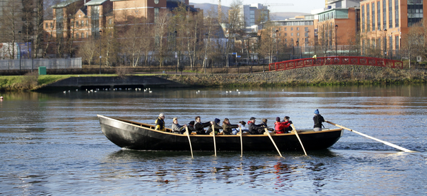 The community group called Lagan Currachs row their 33ft currach on the River Lagan after it was launched