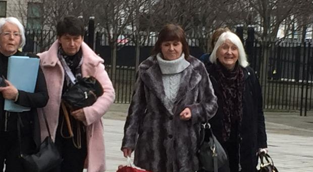 Bernadette McFall, left, and Molly Gilbert, third from left, at Laganside Courts, where they gave evidence to an inquest into the death of their brother Seamus McCollum