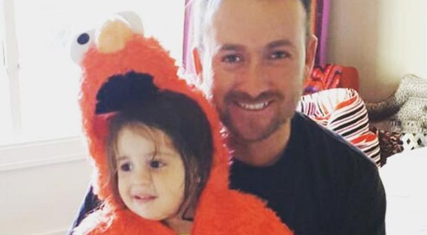 Graeme McDowell and his daughter Vale Esme