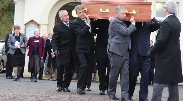 Family members of Hugh Crowe carry his coffin from Kilrea Baptist Church
