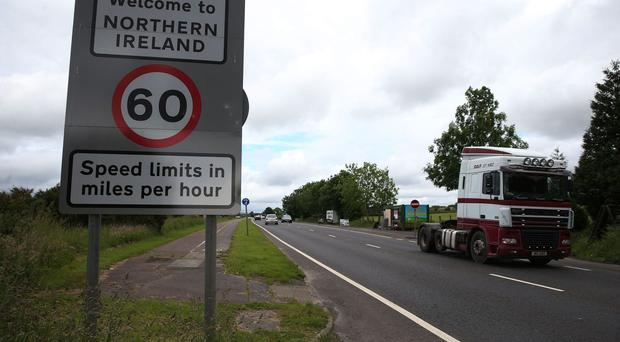 Traffic crosses the border between the Republic of Ireland and Northern Ireland in the village of Bridgend, Co Donegal (File photo)