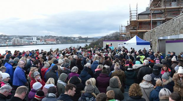 The large crowd at the vigil beside the River Foyle for Jack Glenn