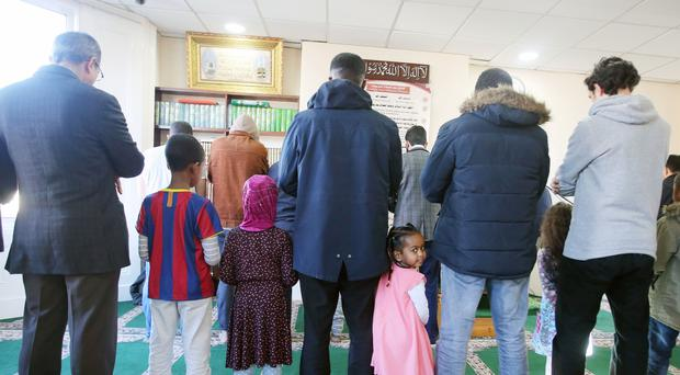 Prayers are said during an open day for the public at Belfast Islamic Centre