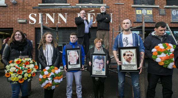 Sinn Fein's Fra McCann introduces Gerry Adams at the commemoration for the murdered Sinn Fein activists Paddy Loughran, Pat McBride and Michael O'Dwyer