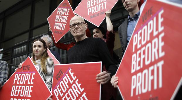 People Before Profit's outgoing MLA Eamonn McCann with party members at a photocall to launch its list of candidates for the election