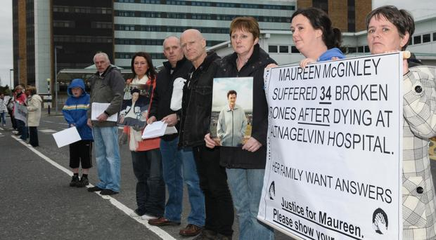Family and friends of Maureen McGinley held protests outside Altnagelvin Hospital after her body was found to have suffered 34 broken bones