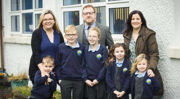 From left: Sandra Simpson with her children, Harry, Charlie and Ashlee, school principal Jason Milligan, and Jill Cash and her children, Leah and Evie