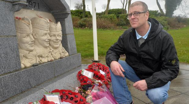 David McCaughey at the monument for the three Scottish soldiers murdered in the IRA honeytrap in 1971