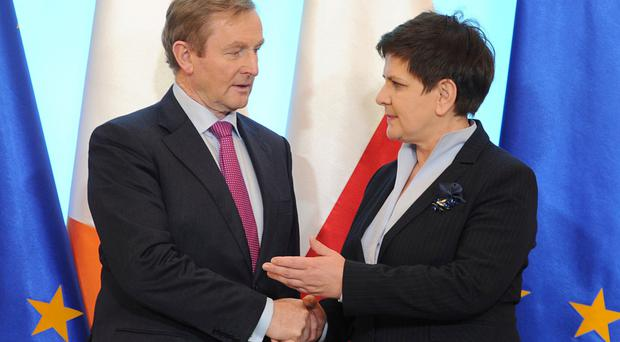 Irish leader Enda Kenny meets his Polish counterpart, Beata Szydlo, after arriving at the Polish prime minister's chancellery in Warsaw