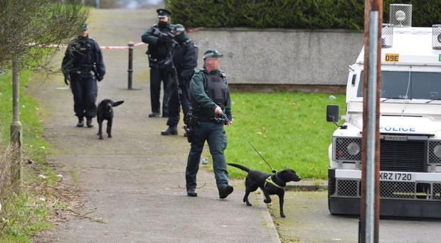Police officers at the scene of a security alert at Allenhill Park, Lurgan