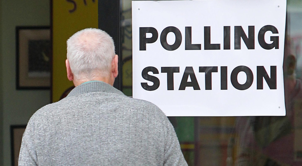A voter attends a previous poll