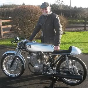 Stanley with his restored Honda CR93