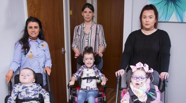 Noah Collins with mum Rachael, Mia Warren with mum Lisa and Caoilte Fitzsimons with mum Fiona