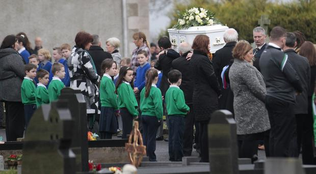 Schoolchildren line the path to St Michael's Chapel for the funeral of John Joe Toner