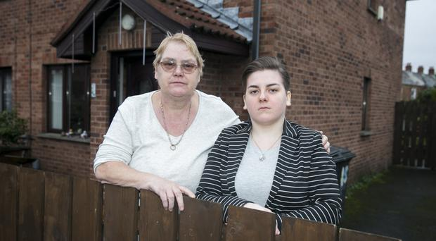 Anne Maginnis with her daughter Deborah outside their family home