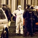 Police and forensics officers at the scene of the latest shooting