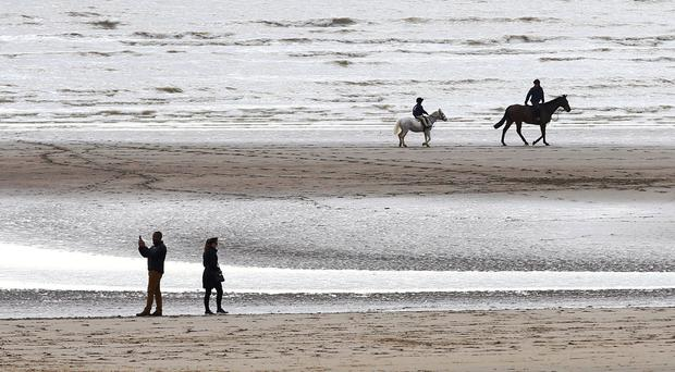 People enjoy the beach at Camber in east Sussex, as a tantalising taste of Spring is set to keep lifting spirits for many into the week ahead - although a return to wet and windy conditions with a risk of gales looms.