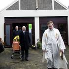 Undertakers with the coffin of 107-year-old Peggy Dunbar after a Funeral Mass by Fr Pat Buckley at his church in Larne
