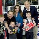 Rhys, Ethan and Callum Thompson, representing the Cancer Fund for Children, drop the ceremonial first puck of the game with parents Gordon and Miriam, Belfast Giant Colin Shields and Cardiff Devil Mark Richardson at an evening hosted by the Rory Foundation (represented by Brian McIlroy)