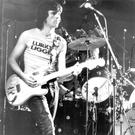 SLF guitarist Henry Cluney on stage in 1978