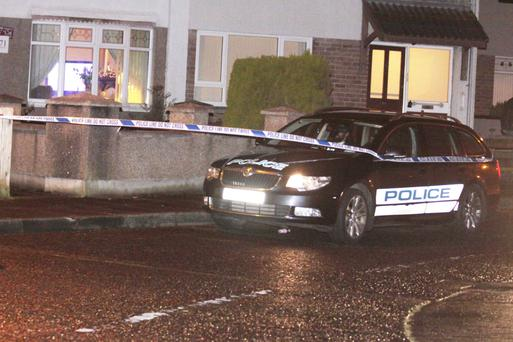 Police at the scene of the double shooting yesterday evening