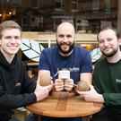 Hillsborough native Tim McKee (centre) joins his partners Callum Drummond (left) and Ellis Williams with their product