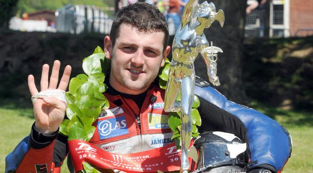 Michael Dunlop with a TT trophy on the Isle of Man