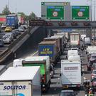 Drivers in the UK's biggest towns and cities spent an average of five days stuck in traffic last year, a study has found