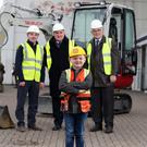 Ross Patterson becomes foreman for the day, joined by (from left) Brian McGivern of Killowen Contracts, Peter McNaney of Belfast HSC Trust and Felix Mooney of the Children's Cancer Unit Charity