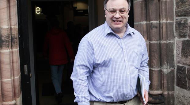 Stephen Farry leaves the Crescent Arts Centre after taking part in the Talkback show yesterday