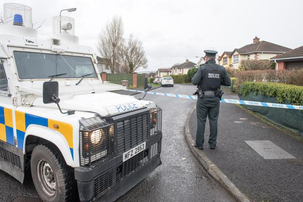 Police at the scene of the explosion in the Culmore area of Londonderry yesterday