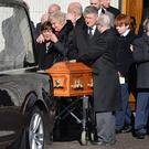Mourners at the funeral of Ryan Philips at St Colman's Church, Lambeg, yesterday