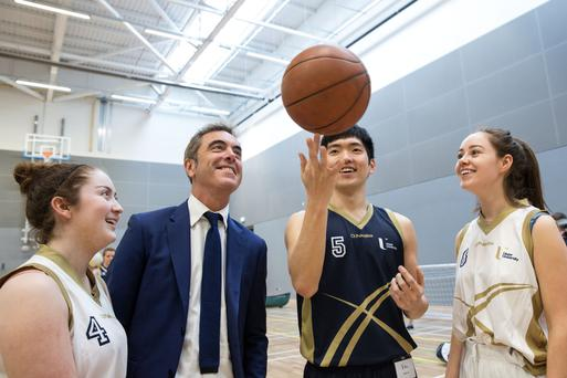 James Nesbitt with students as he opens a £5.1m sports complex at the University of Ulster