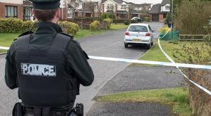 Police at the scene of Wednesday's murder attempt on a colleague in Derry