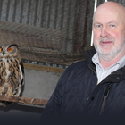 Seamus McAleese with two European Eagle Owls