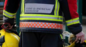 A man is in a critical but stable condition after being rescued from a fire at a flat in Armagh.