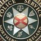 The Police Service of Northern Ireland said tyres were placed against the rear of a building and set on fire