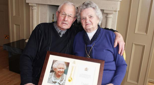 Diamond wedding couple Stuart and Mary Nicholl with the letter of congratulations from the Queen